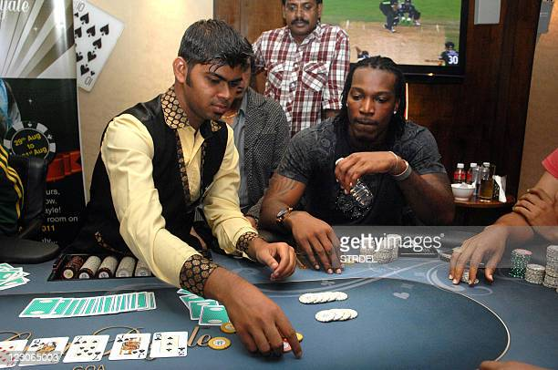 West Indies cricketer Chris Gayle plays poker on a floating casino in Panaji Goa on August 29 2011 Chris Gayle is on a threeday visit to Goa invited...