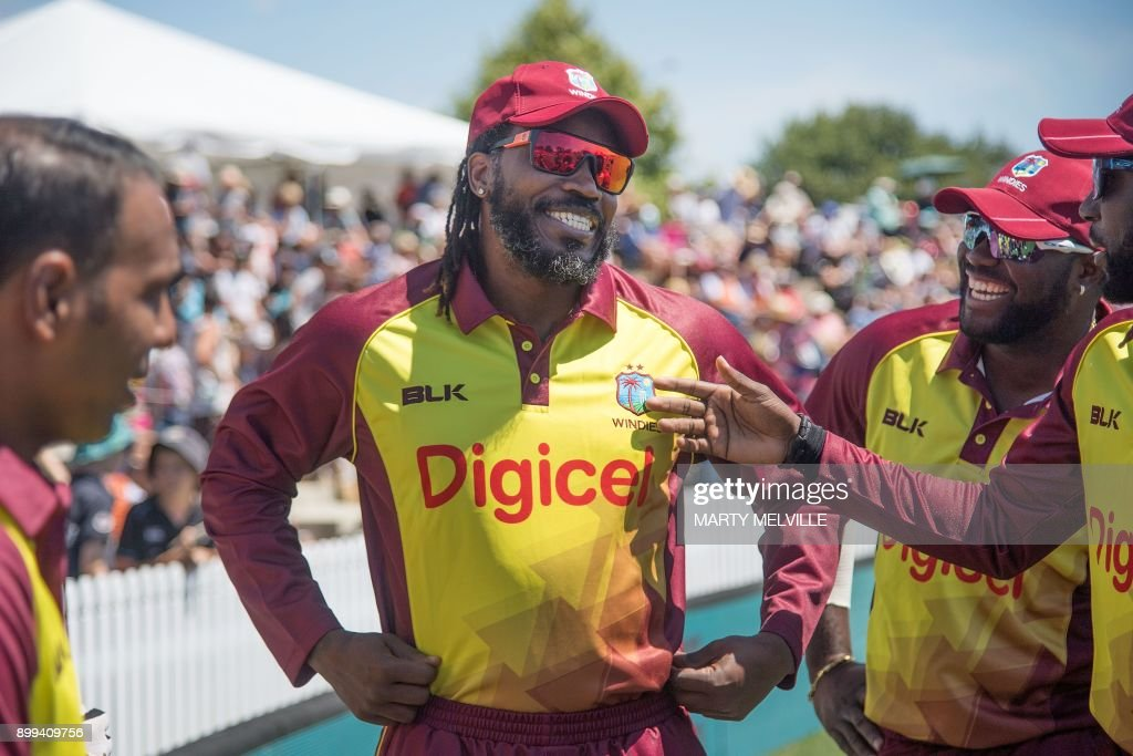 West Indies cricketer Chris Gayle (C) waits to walk onto the field with teammates for the first Twenty20 international cricket match between New Zealand and the West Indies at Saxton Oval in Nelson...