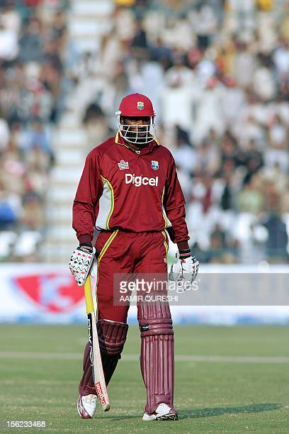 West Indies cricketer Christopher Gayle walks back to the pavilion after his dismissal by Pakistani bowler Rana NavedulHassan during the fourth...