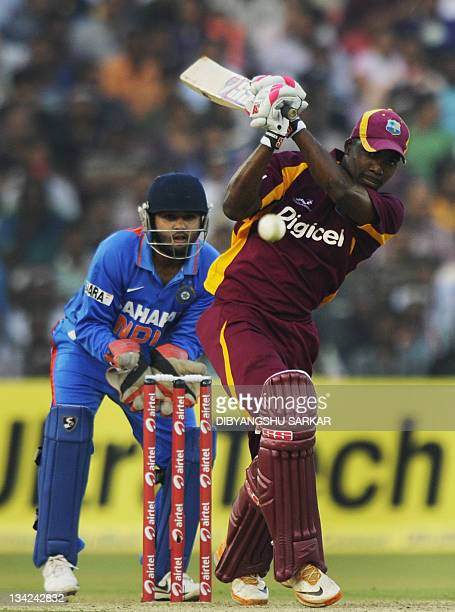 West Indies cricketer Darren Bravo plays a shot as Indian wicketkeeper Parthiv Patel looks on during the first One Day International cricket match...