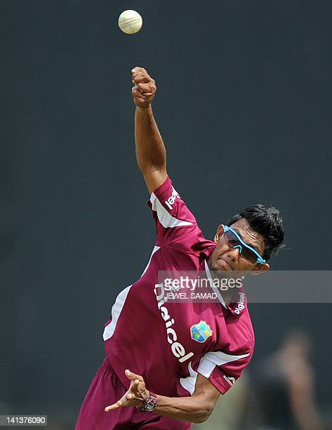 West Indies cricketer Devendra Bishoo delivers a ball during a practice session at the Arnos Vale Ground in Kingstown on March 15, 2012. West Indies...