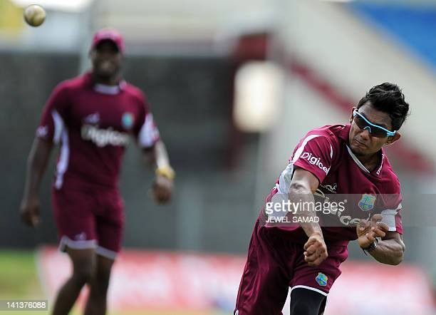 West Indies cricketer Devendra Bishoo throws a ball during a practice session at the Arnos Vale Ground in Kingstown on March 15 2012 West Indies will...