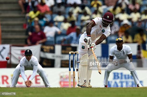 West Indies cricketer Devon Smith plays a shot off England's bowler James Anderson during the second Test match between West Indies and England at...