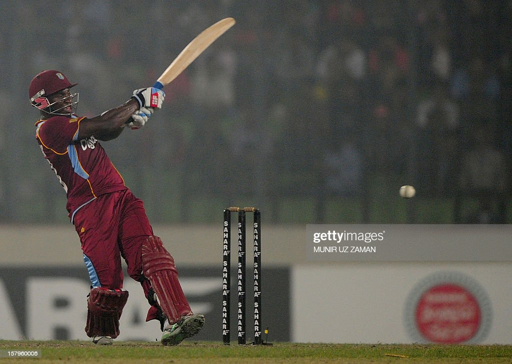 West Indies cricketer Devon Thomas plays a shot during the fifth one day international between Bangladesh and West Indies at The Sher-e-Bangla National Cricket Stadium in Dhaka on December 8, 2012. AFP PHOTO/ Munir uz ZAMAN