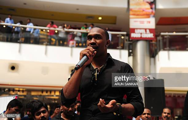 West Indies cricketer Dwayne Bravo attends the launch of the 'Ultimate Sports Coaching' cricket camp in Chennai on April 6 2016 The West Indies'...