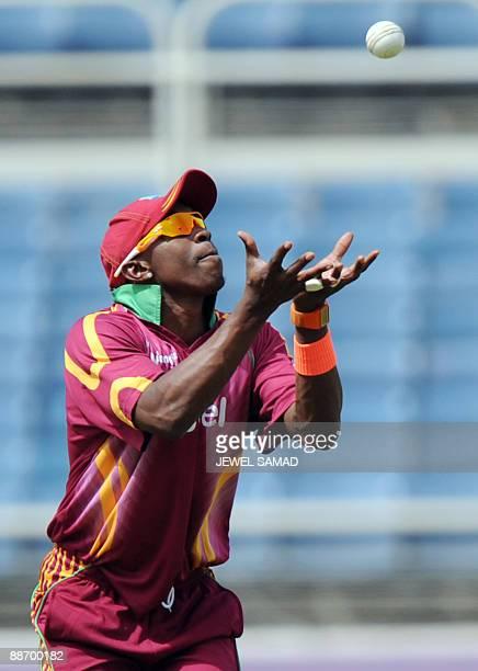 West Indies cricketer Dwayne Bravo catches the ball to dismiss Indian batsman Gautam Gambhir during the first One Day International match between...