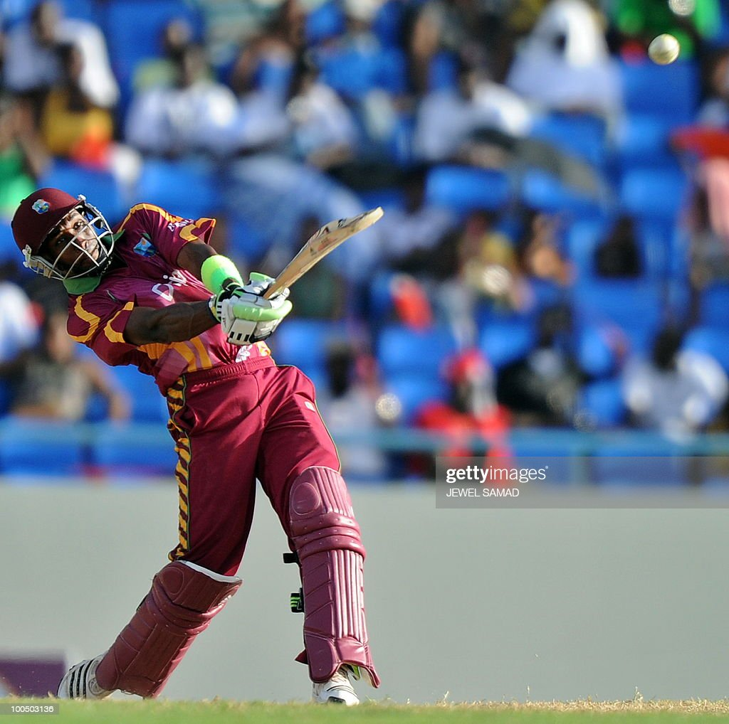 West Indies cricketer Dwayne Bravo hits a boundary off South African bowler Lonwabo Tsotsobe during the second One Day International match between West Indies and South Africa at the Sir Vivian Richards Stadium in St John's on May 24, 2010. Batting first, South Africa scored 300-runs at the end of their innings. AFP PHOTO/Jewel Samad