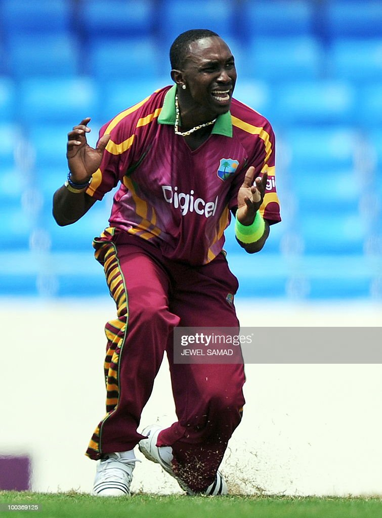 West Indies cricketer Dwayne Bravo reacts as his teammate fails to take a catch to dismiss South African cricket team captain Graeme Smith during the second One Day International match between West Indies and South Africa at the Sir Vivian Richards Stadium in St John's on May 24, 2010. AFP PHOTO/Jewel Samad