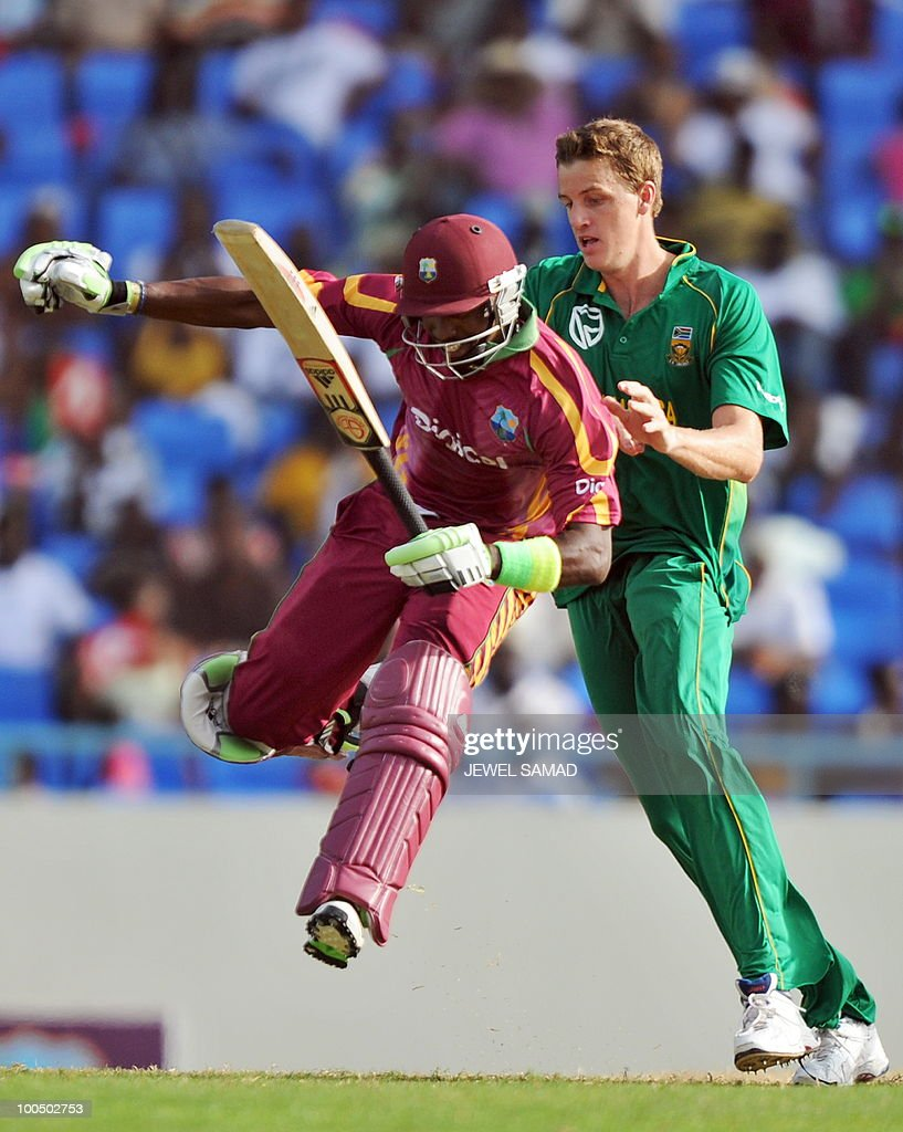 West Indies cricketer Dwayne Bravo (L) spins in the air to avoid a collision with South African bowler Morne Morkel as he takes a run during the second One Day International match between West Indies and South Africa at the Sir Vivian Richards Stadium in St John's on May 24, 2010. Batting first, South Africa scored 300-runs at the end of their innings. AFP PHOTO/Jewel Samad