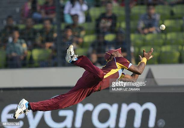 West Indies cricketer Dwayne Bravo takes a catch to dismiss Australia cricketer James Faulkner during the ICC World Twenty20 tournament Group 2...