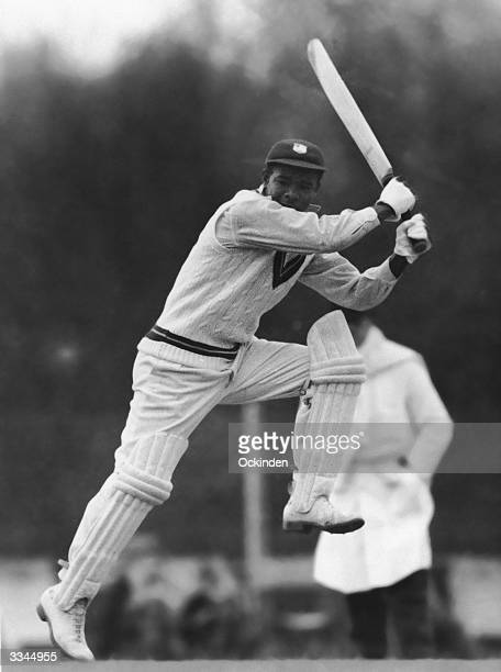West Indies cricketer Everton Weekes batting energetically at Kingston against a Club Cricket Conference team 28th April 1950