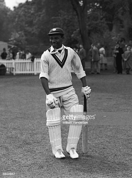 West Indies cricketer Everton Weekes heading out to bat against Cambridge University 10th June 1950
