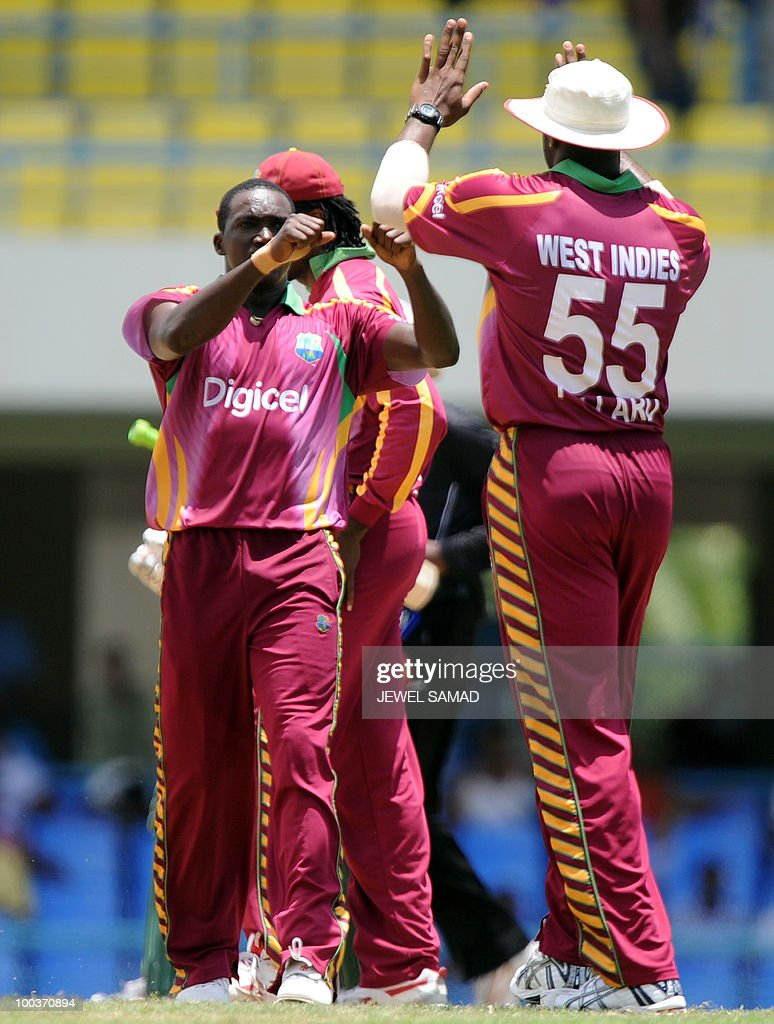 West Indies cricketer Jerome Taylor (L) celebrates with teammates after dismissing South African batsman Hashim Amla during the second One Day International match between West Indies and South Africa at the Sir Vivian Richards Stadium in St John's on May 24, 2010. Amla scored 92-runs before being dismissed. AFP PHOTO/Jewel Samad
