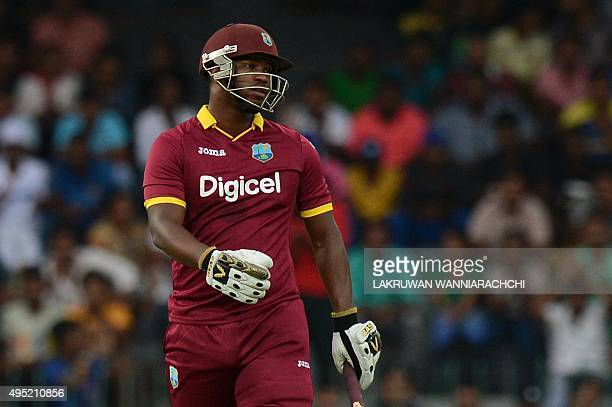 West Indies cricketer Johnson Charles walks back to the pavilion after his dismissal during the first One Day International match between Sri Lanka...
