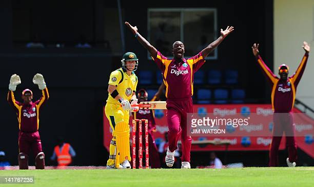 West Indies cricketer Kemar Roach protests as Australian cricketer David Warren looks on during the fourthoffive One Day International matches...