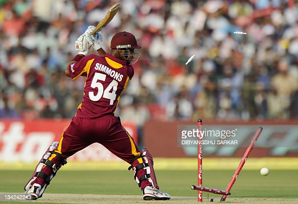 West Indies cricketer Lendl Simmons looks back towards his shattered wicket after he was clean bowled during the first one day international cricket...
