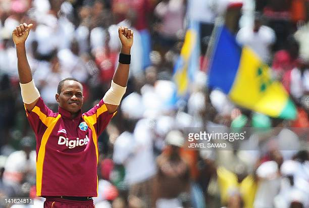 West Indies cricketer Marlon Samuels celebrates dismissing Australian batsman George Bailey during the third-of-five One Day International matches...