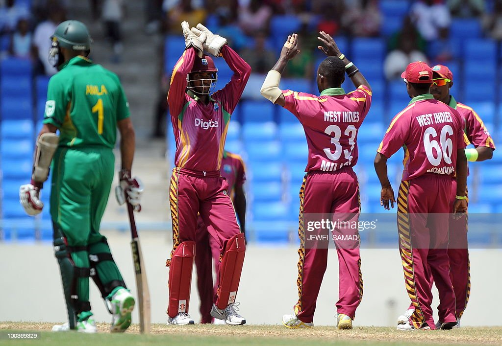 West Indies cricketer Nikita Miller (C) celebreates with teammates after dismissing South African cricket team captain Graeme Smith during the second One Day International match between West Indies and South Africa at the Sir Vivian Richards Stadium in St John's on May 24, 2010. AFP PHOTO/Jewel Samad