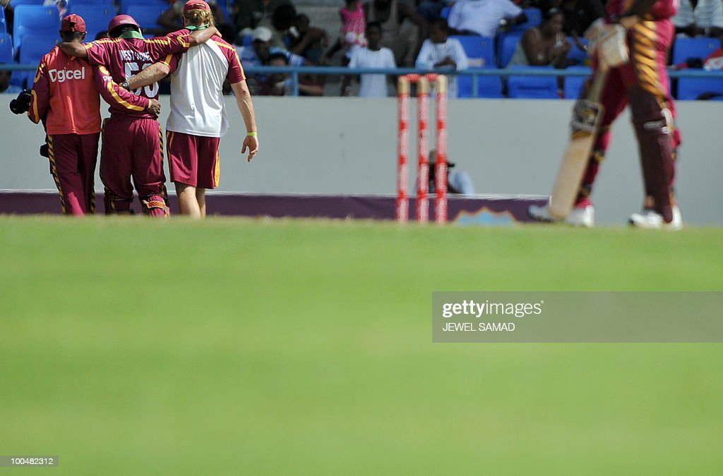 West Indies cricketer Ramnaresh Sarwan (2nd L) is helped by teammates as he leaves the field after being injured while taking a run during the second One Day International match between West Indies and South Africa at the Sir Vivian Richards Stadium in St John's on May 24, 2010. Batting first, South Africa scored 300-runs at the end of their innings. AFP PHOTO/Jewel Samad