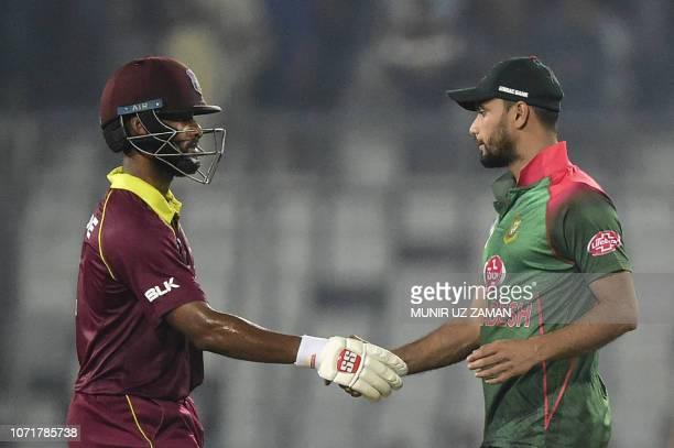 West Indies cricketer Shai Hope shakes hands with Bangladesh cricket captain Mashrafe Bin Mortaza after winning the second oneday international...
