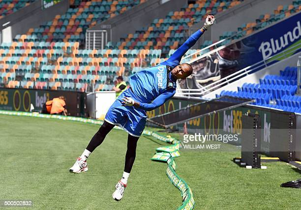 West Indies cricketer Shane Dowrich catches the ball on the boundary as they train ahead of the first cricket Test match against Australia in Hobart...