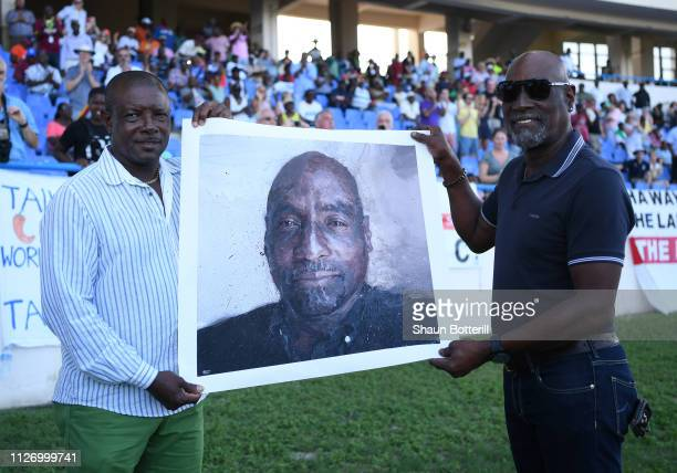 West Indies cricketer Sir Vivian Richards with a print by artist Brandan Kelly presented to him by friend Richie Richardson during Day Three of the...