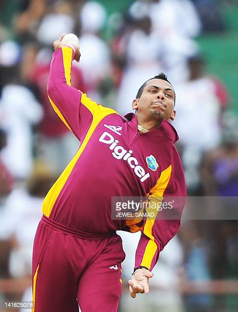 West Indies cricketer Sunil Narine delivers a ball during the third-of-five One Day International matches between West Indies and Australia at the...