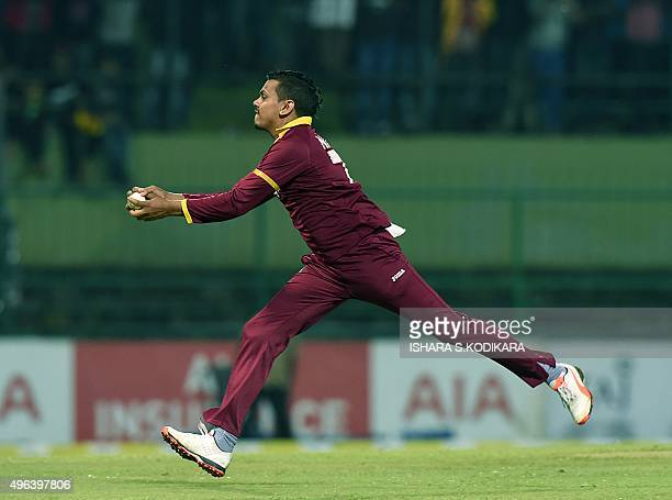 West Indies cricketer Sunil Narine takes a catch to dismiss Sri Lankan cricketer Shehan Jayasuriya during the first Twenty20 International cricket...