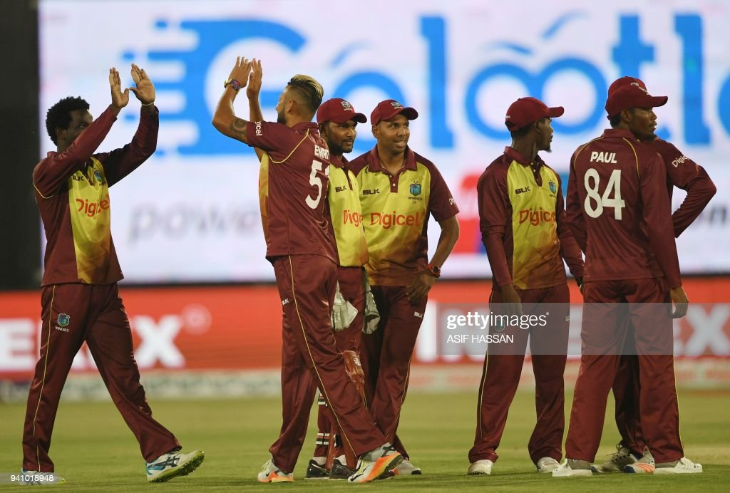 West Indies cricketers celebrate after the dismissal of Pakistani batsman Fakhar Zaman during the second Twenty20 (T20) International cricket match between Pakistan and West Indies at the National Cricket Stadium in Karachi on April 2, 2018. Pakistan captain Sarfraz Ahmed won the toss and opted to bat in the second Twenty20 international against the West Indies in Karachi. /