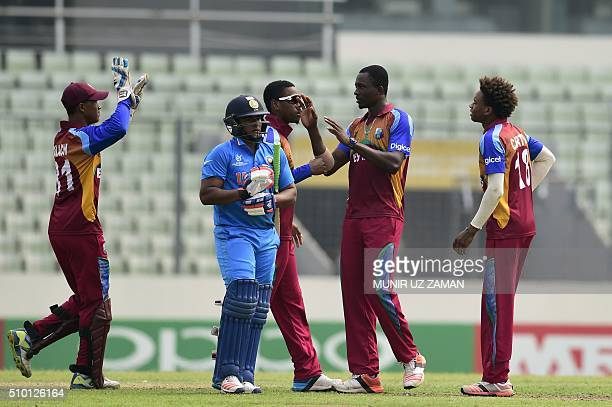 West Indies cricketers celebrate after the dismissal of the Indian cricketer Sarfaraz Khan during the under19s World Cup cricket final between India...