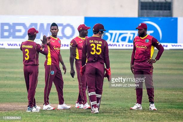 West Indies' cricketers celebrate the dismissal of Bangladesh's Liton Das during the first one-day international cricket match between Bangladesh and...