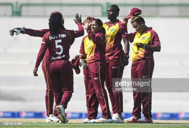 West Indies cricketers celebrate the dismissal of Pakistani cricketer Javeria Khan during the first Twenty20 match between Pakistan and West Indies'...