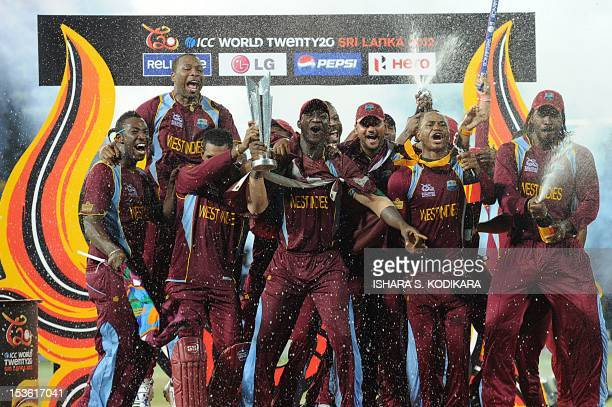 West Indies cricketers celebrate their victory in the ICC Twenty20 Cricket World Cup's final match against Sri Lanka at the R. Premadasa...