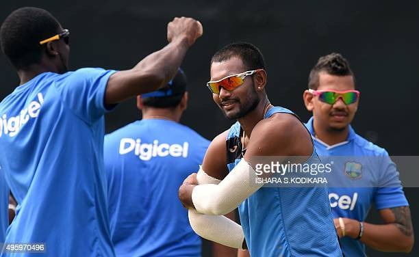 West Indies cricketers Denesh Ramdin , Sunil Narine and stretch with teammates during a practice session at the Pallekele International Cricket...