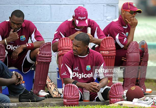 West Indies cricketers Dwayne Bravo , Darren Bravo and Carlton Baugh wait to bat during a practice session at the Arnos Vale Ground in Kingstown on...