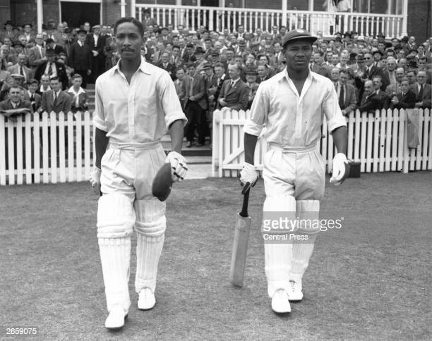 West Indies cricketers Frank Worrell and Everton Weekes go out to resume their recordmaking innings against England at Trent Bridge