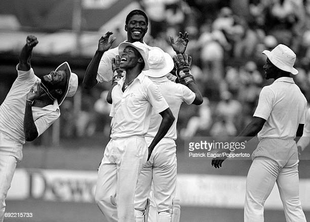 West Indies cricketers Malcolm Marshall Carlisle Best Joel Garner Thelston Payne and Richie Richardson celebrate a wicket during the 2nd Test match...