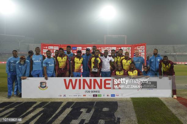 West Indies cricketers pose with the tournament trophy following the third Twenty20 cricket match between Bangladesh and West Indies at the...
