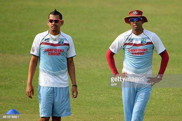 West Indies cricketers Samuel Badree and Sunil Narine attend the training session at The ShereBangla National Cricket Stadium in Dhaka on April 2...