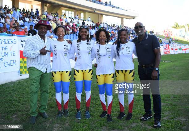 West Indies cricketers Sir Vivian Richards and Richie Richardson pose with Antiguan rowers Elvira Bell, Christal Clashing, Kevinia Francis and Samara...