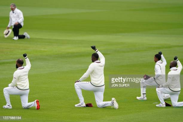 West Indies cricketers take the knee on the first day of the second Test cricket match between England and the West Indies at Old Trafford in...