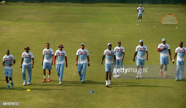 West Indies cricketers warm up during the training session at The ShereBangla National Cricket Stadium in Dhaka on April 2 2014 Sri Lanka plays West...