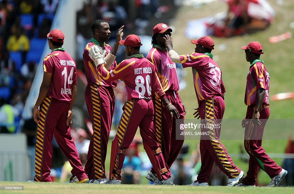 West Indies crickter Kieron Pollard (2nd-L) celebrates with teammates after dismiss South African batsman Jacques Kallis during the second One Day International match between West Indies and South Africa at the Sir Vivian Richards Stadium in St John's on May 24, 2010. Kallis scored 85-runs before being dismissed. AFP PHOTO/Jewel Samad