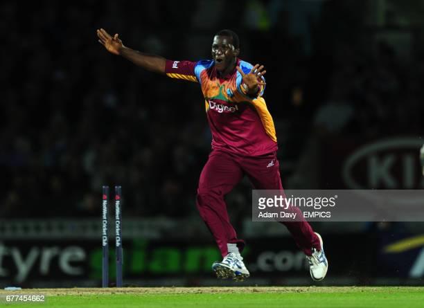 West Indies' Darren Sammy celebrates running out England's Josh Butler