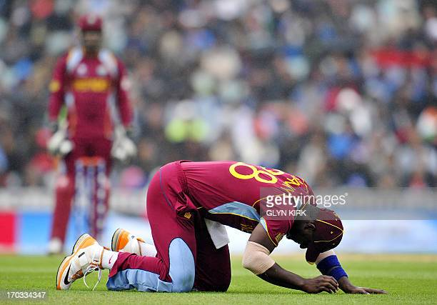 West Indies' Darren Sammy gestures after missing a catch during the 2013 ICC Champions Trophy One Day International cricket match between India and...