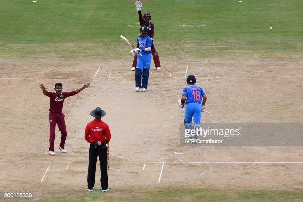 West Indies' Devendra Bishoo successfully appeals for LBW against India's Shikhar Dhawan during the first One Day International match between West...