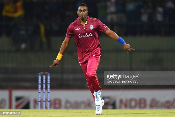 West Indies' Dwayne Bravo celebrates after dismissing Sri Lanka's Kusal Mendis during the second Twenty20 international cricket match of a twomatch...
