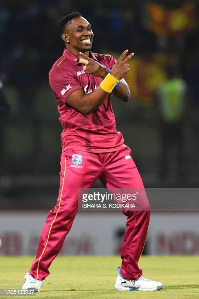 West Indies' Dwayne Bravo celebrates after dismissing Sri Lanka's Kusal Mendis during the second Twenty20 international cricket match of a twomatch...