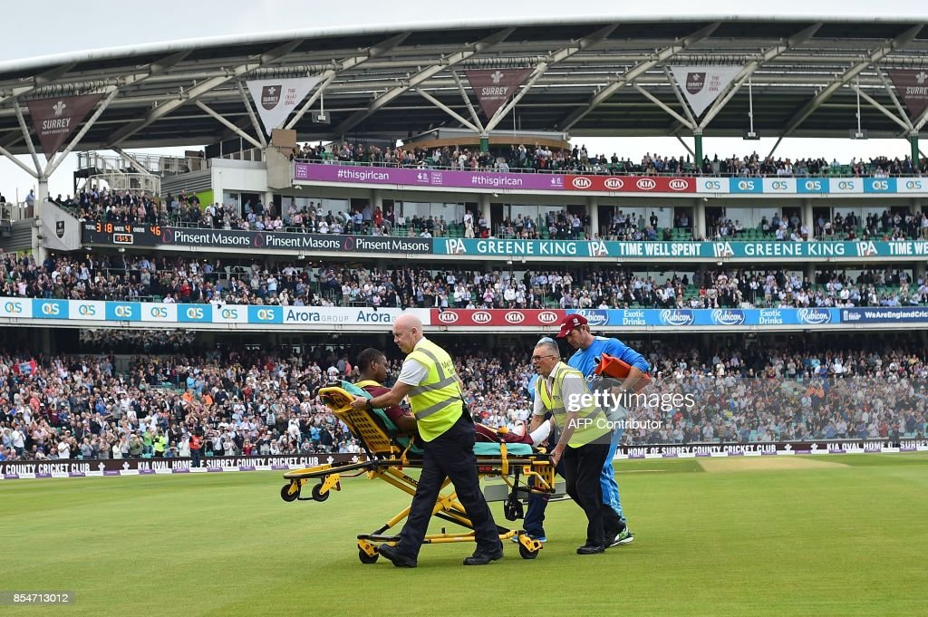 West Indies' Evin Lewis sits on a stretcher as he is taken off of the pitch after being hit by the ball during the fourth One-Day International (ODI) cricket match between England and the West Indies at the Oval in London on September 27, 2017. / AFP PHOTO / Glyn KIRK / RESTRICTED