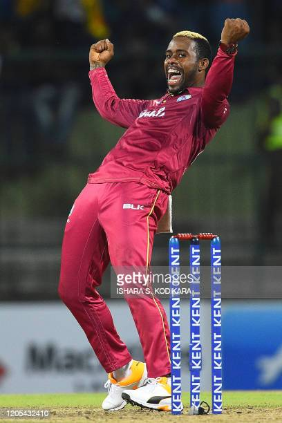 West Indies' Fabian Allen celebrates after dismissing Sri Lanka's Shehan Jayasuriya during the second Twenty20 international cricket match of a...